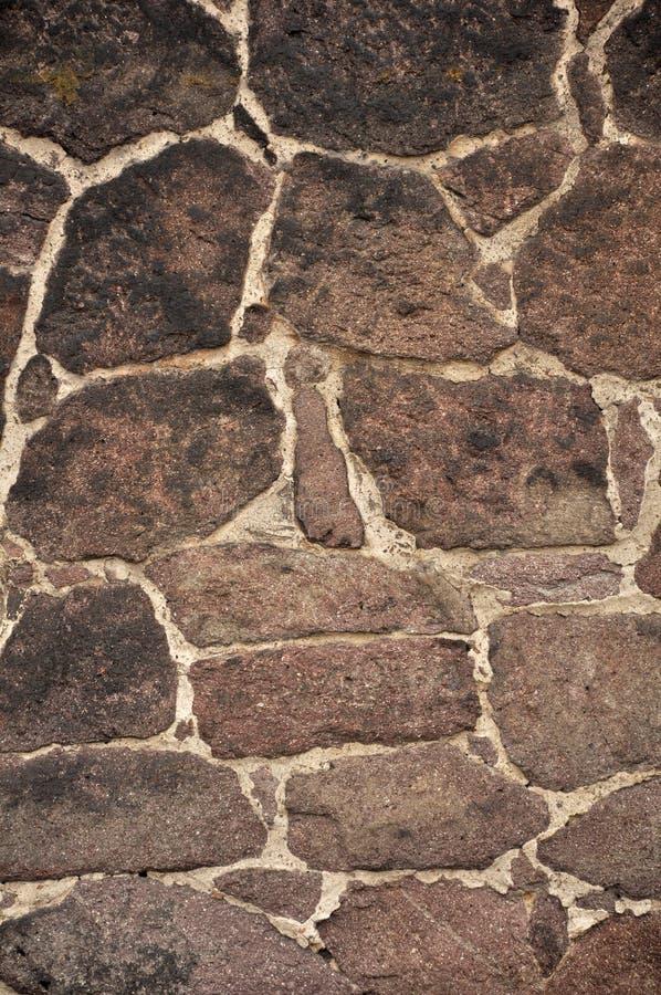黑暗的模式石墙 免版税库存图片