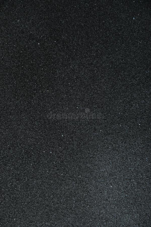 黑暗的水泥背景 有copyspace的黑纹理墙壁 库存图片