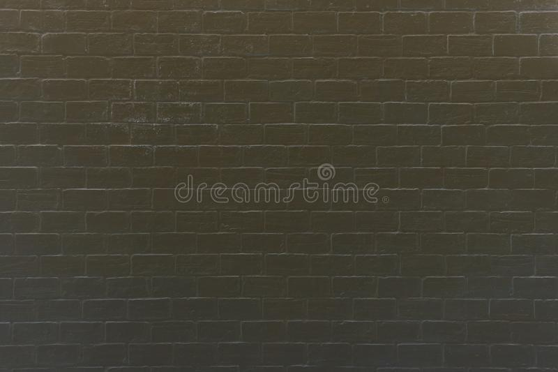 黑暗的砖墙的样式 免版税库存照片