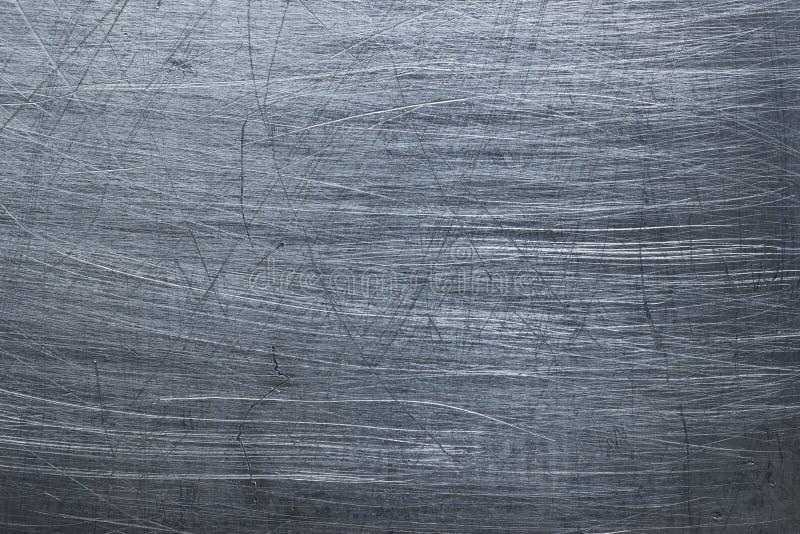 黑暗的金属背景,钢纹理使古色变黑 免版税库存图片