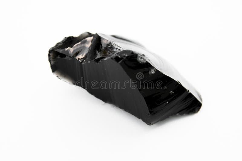 黑曜石矿物被隔绝在白色 库存照片