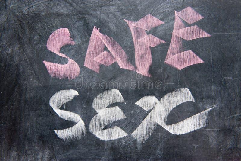 黑板安全性交文字 图库摄影