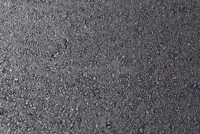 黑柏油路柏油碎石地面表面纹理 免版税库存图片
