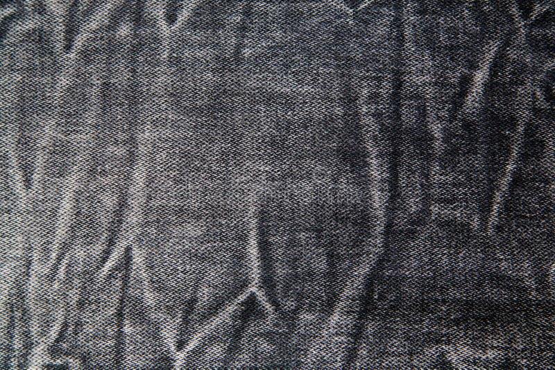 黑牛仔裤纹理 免版税库存照片