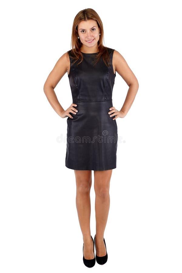 黑皮革礼服身分和lookin的美丽的少妇 库存照片