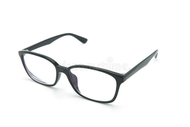 黑眼睛与发光的黑框架的玻璃眼镜的对一个人的读的日常生活以视觉缺陷 奶油被装载的饼干 免版税库存图片