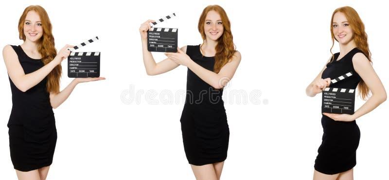 黑礼服藏品拍板板的年轻女人 图库摄影