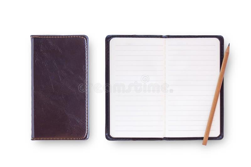 黑笔记本的顶视图汇集在白色背景书桌f上的 免版税库存图片