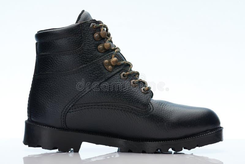 黑粗砺的皮鞋侧视图 免版税库存照片