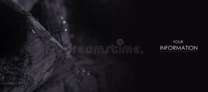 黑织品纹理材料闪耀衣服饰物之小金属片发光样式 图库摄影