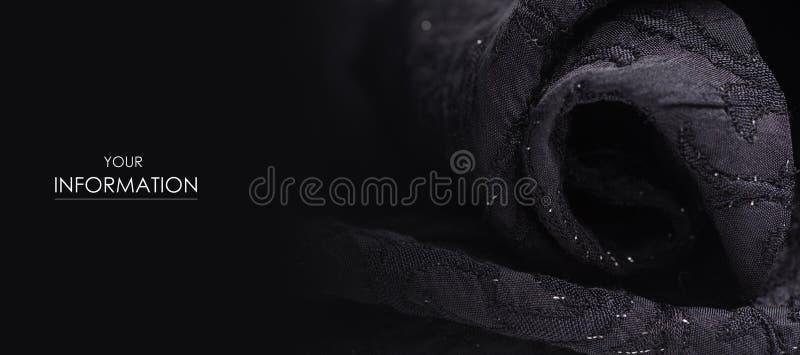 黑织品纹理材料闪耀衣服饰物之小金属片发光样式 免版税库存图片