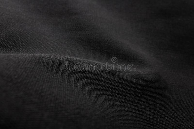 黑织品纹理背景 帆布纺织材料细节  免版税库存图片