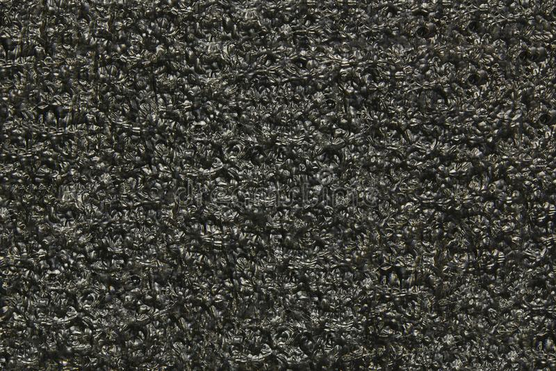 黑聚氨酯背景 以一起被胶合的球的形式纹理 免版税库存照片