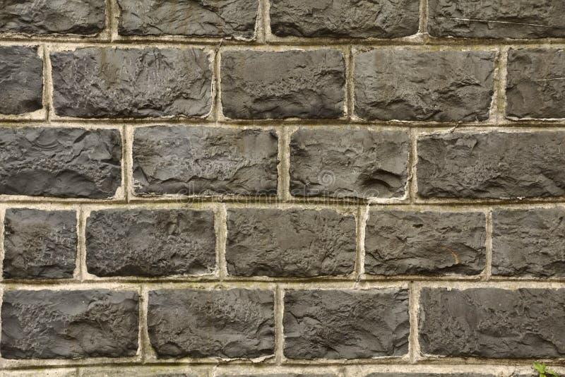黑自然石墙 库存照片