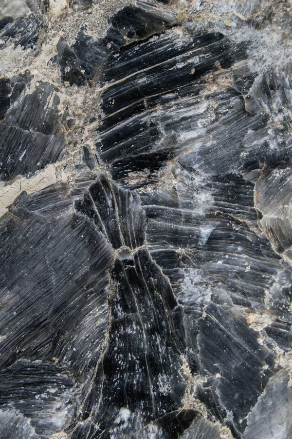 黑自然石纹理/背景分层了堆积 免版税图库摄影