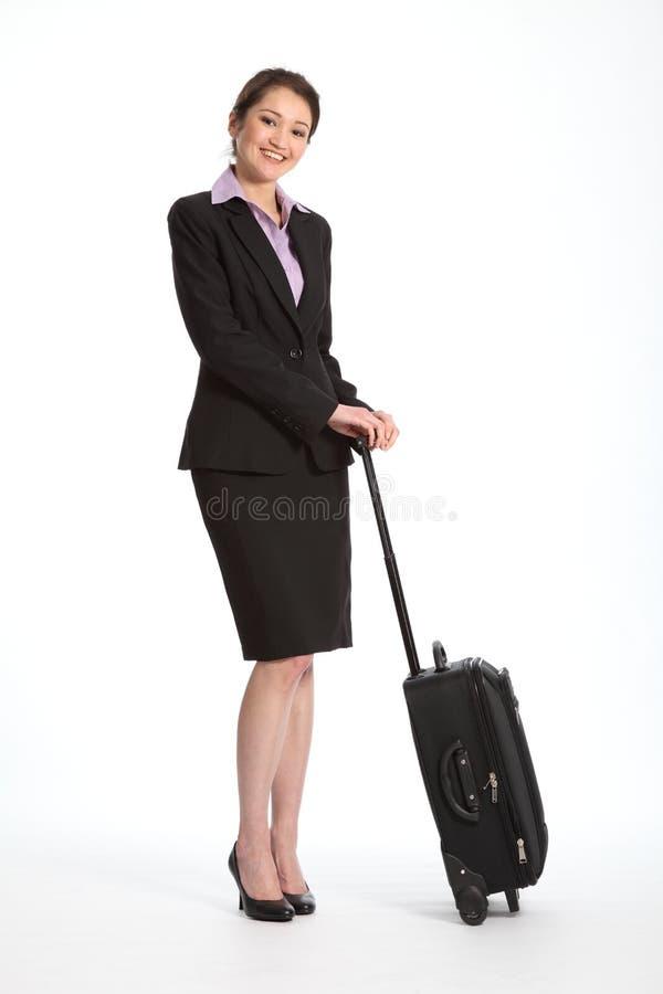 黑色企业微笑的诉讼旅行家妇女 库存照片