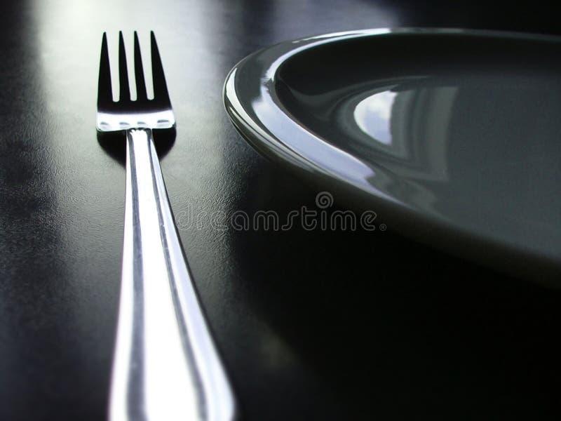 黑色刀叉餐具白色 免版税库存照片