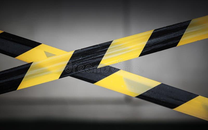 黑色和黄色镶边磁带 免版税库存照片