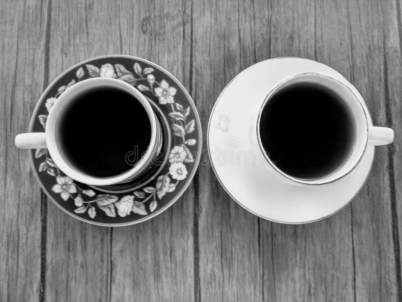 黑色咖啡中的对立物 免版税图库摄影