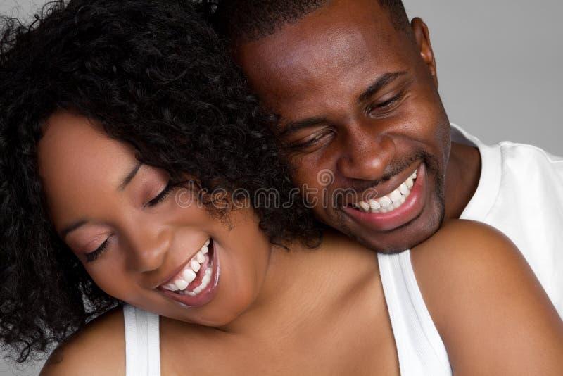 黑色夫妇笑 免版税图库摄影