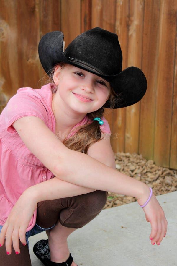 黑色女孩帽子西部的一点 库存照片