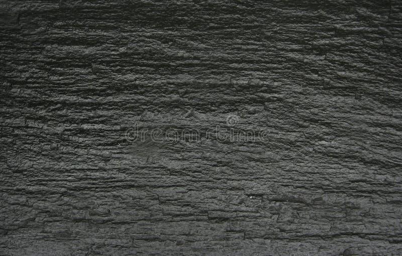 黑色岩石纹理 免版税库存图片