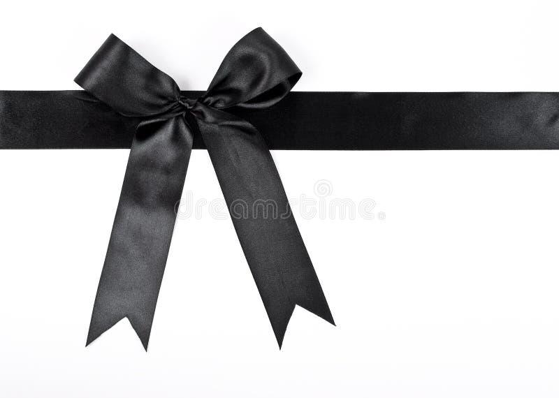 黑色弓丝带 免版税库存照片