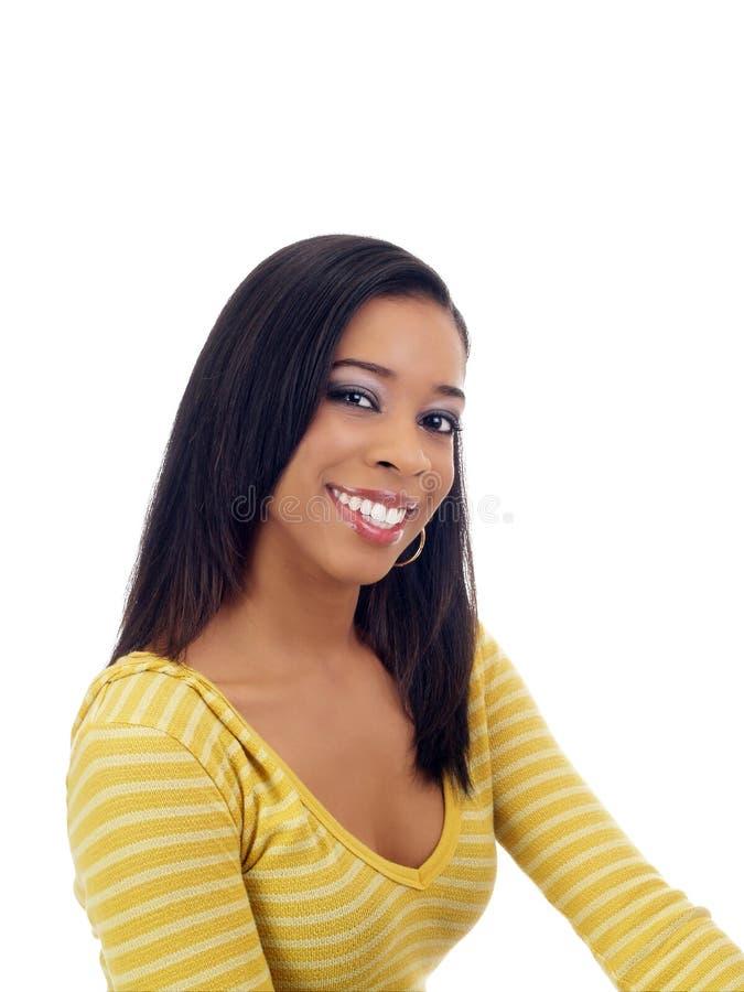黑色微笑的毛线衣妇女黄色年轻人 库存照片