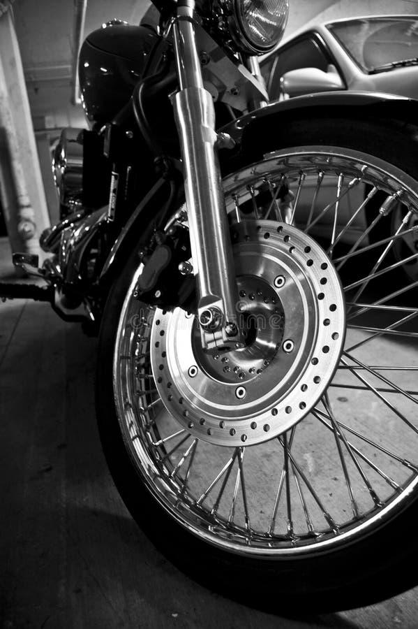 黑色摩托车白色 免版税库存图片