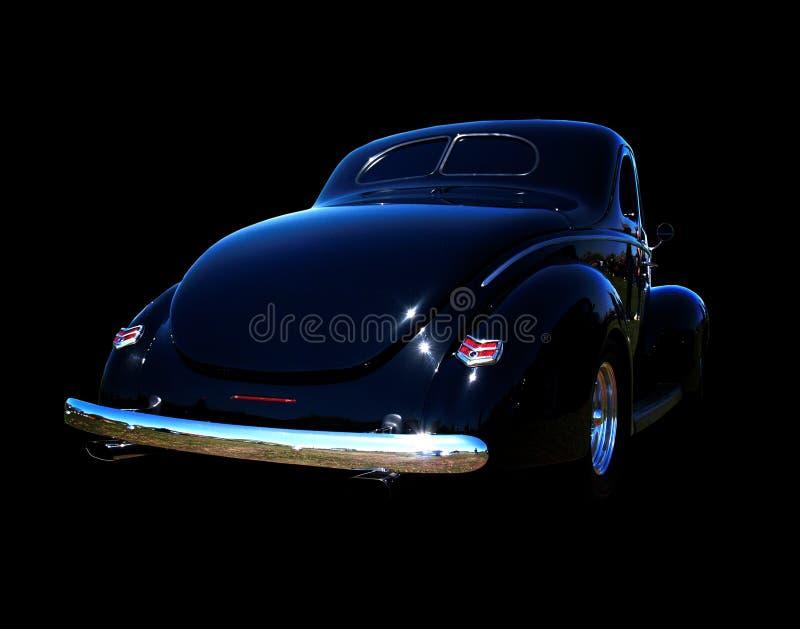 黑色旧车改装的高速马力汽车 库存照片