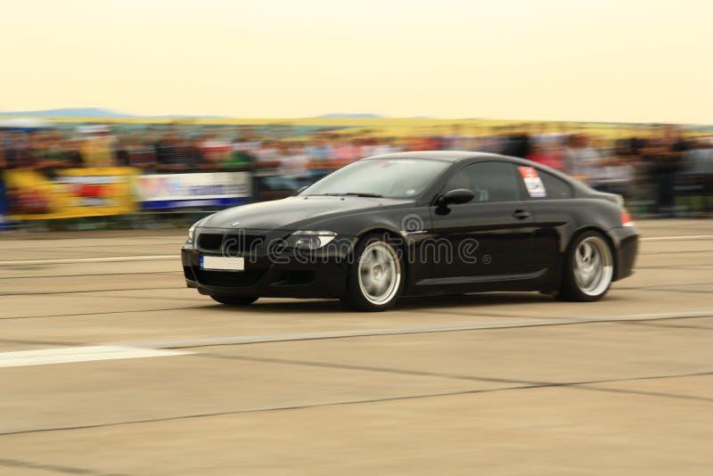 黑色汽车加速 免版税图库摄影