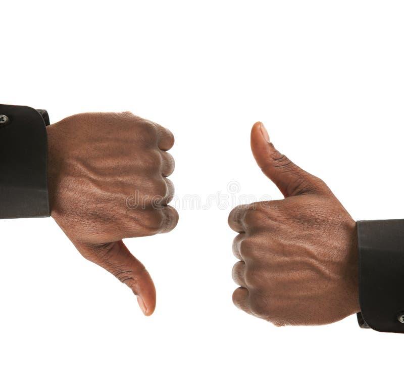 黑色生意人下来打手势现有量  库存照片