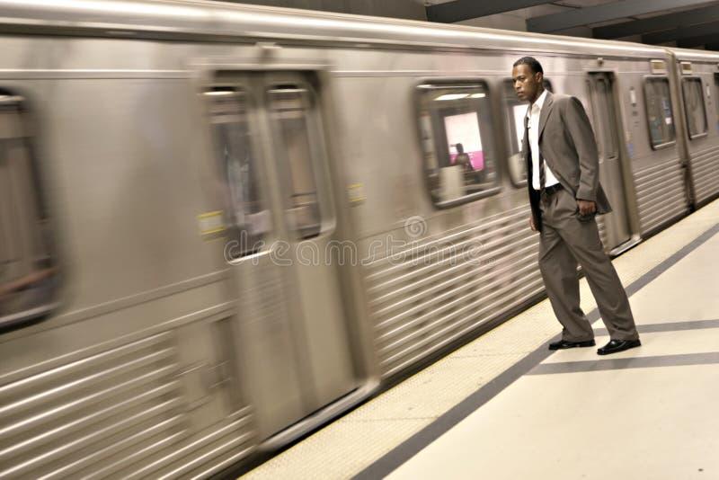 黑色生意人地铁通过培训注意 免版税库存图片