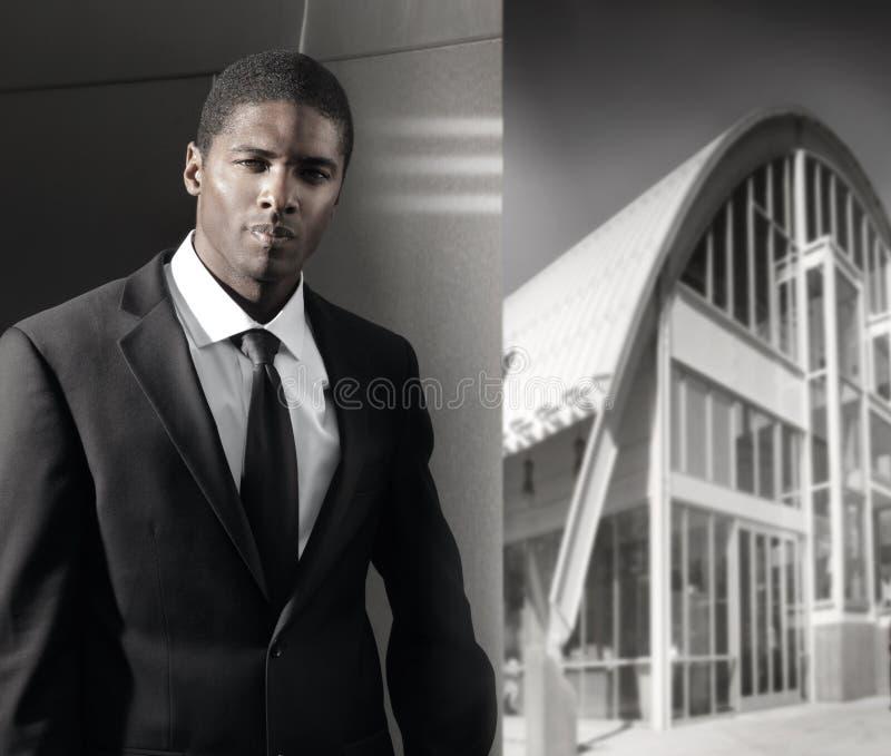 黑色生意人年轻人 免版税库存照片