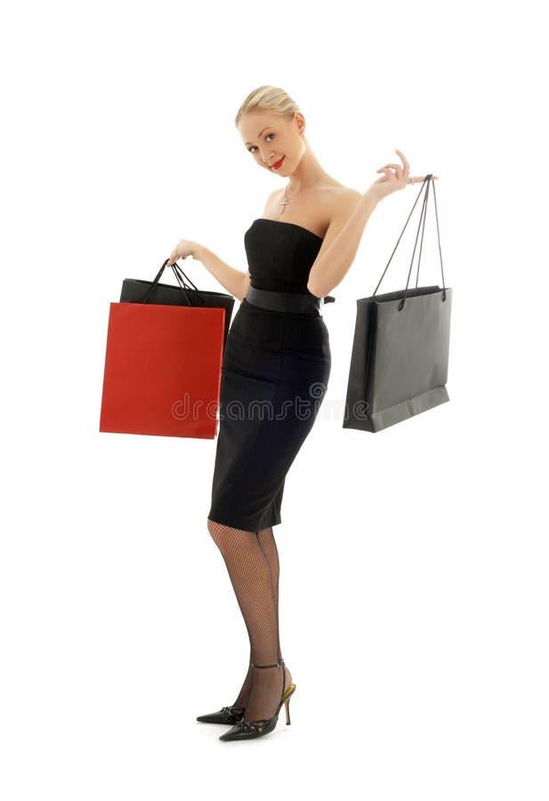 黑色白肤金发的礼服购物 免版税库存图片
