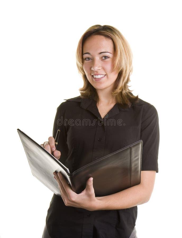 黑色白肤金发的笔记本衬衣文字 库存照片