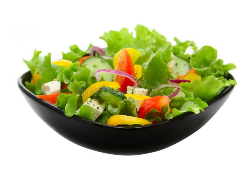 黑色的盘子沙拉正方形蔬菜 库存照片