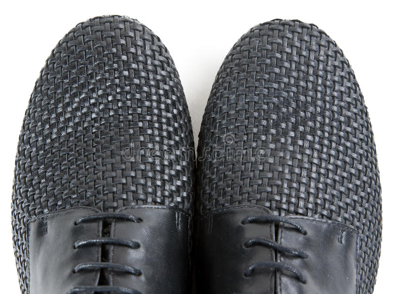 黑色皮革对穿上鞋子时髦 库存照片