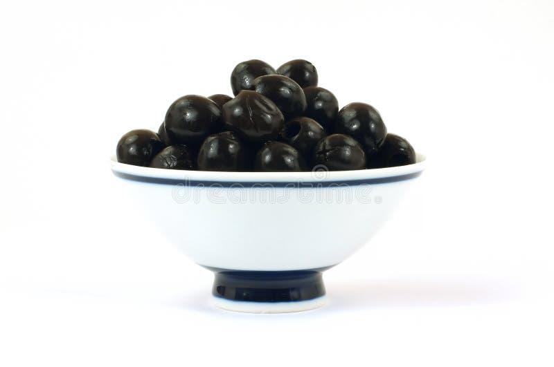 黑色碗橄榄挖坑了白色 图库摄影