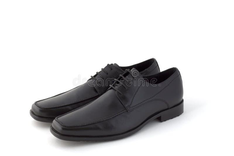 黑色礼服人对s鞋子 免版税库存照片