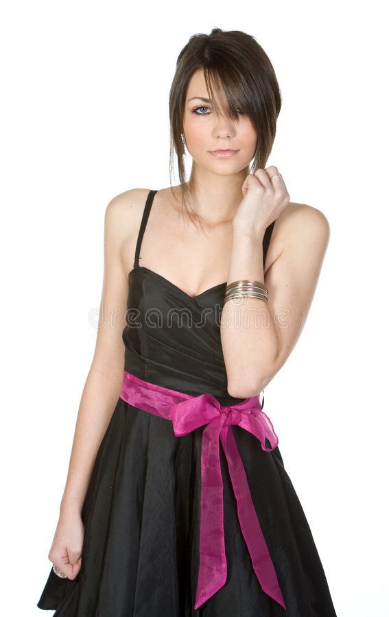 黑色礼服俏丽的少年 免版税库存照片