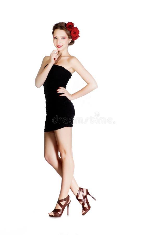 黑色礼服女孩短小 图库摄影