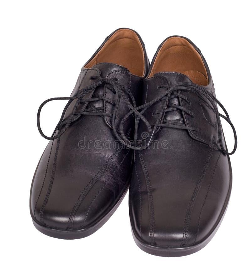 黑色穿上鞋子白色 图库摄影
