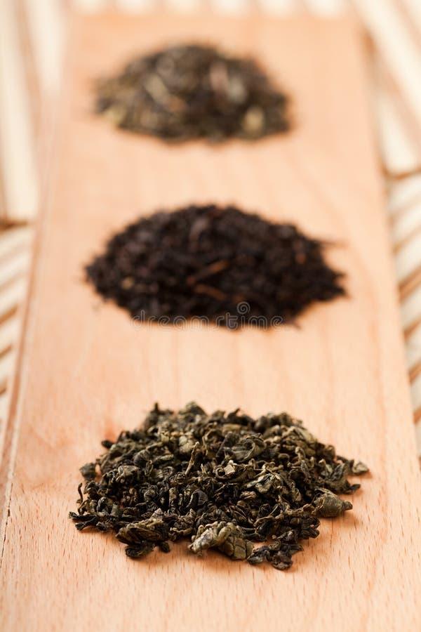 黑色绿色jiaogulan茶 免版税库存照片