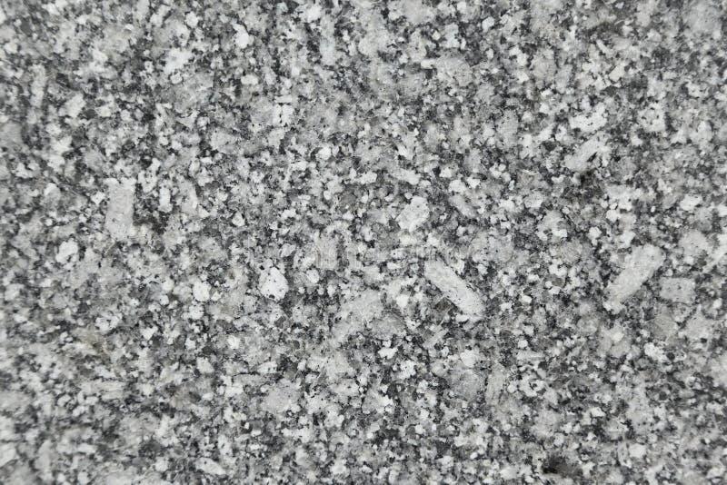 黑色花岗岩优美的纹理白色 免版税库存照片