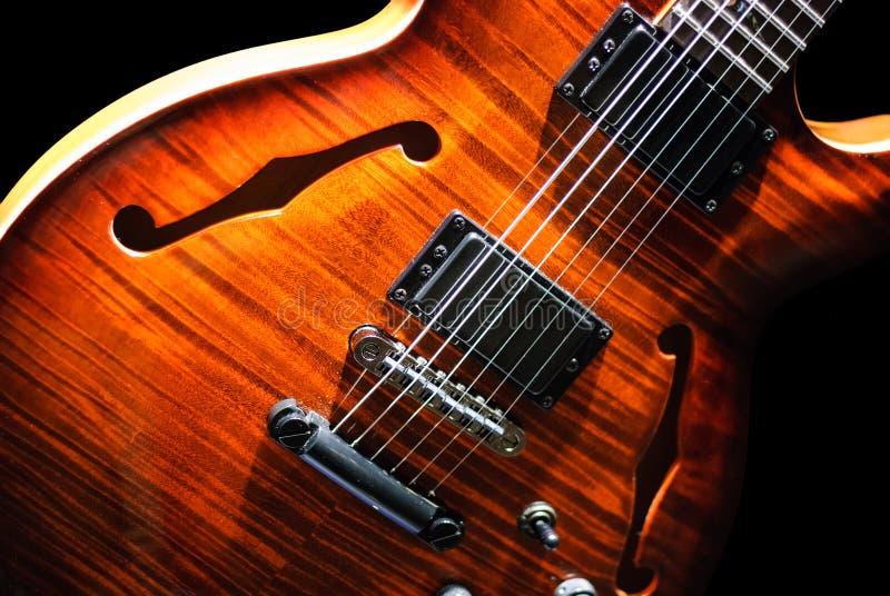 黑色蓝色吉他 免版税库存照片