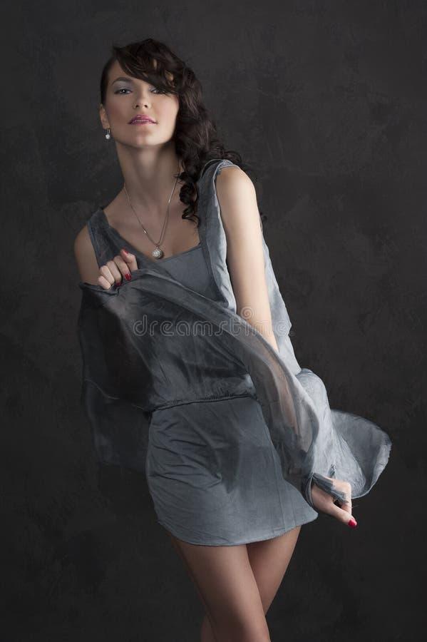 黑色蓝色礼服女孩光 免版税库存图片