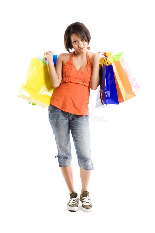 黑色购物疲乏的妇女 免版税库存照片