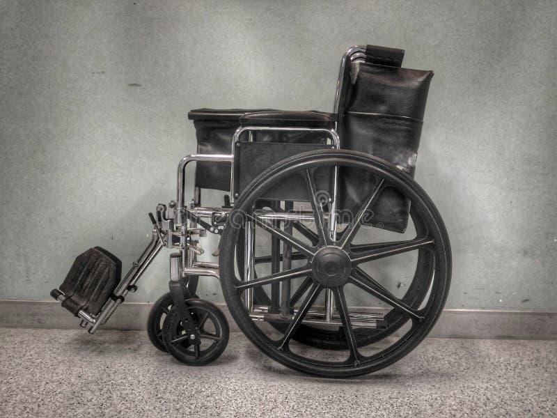 黑色轮椅 免版税库存图片