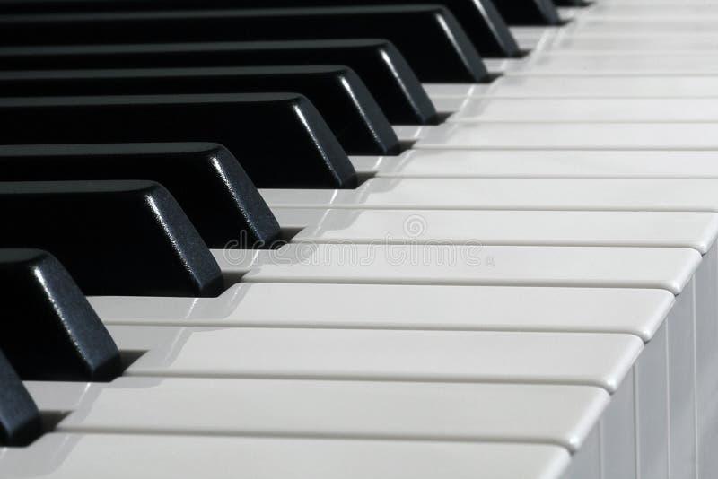 黑色锁上钢琴白色 图库摄影